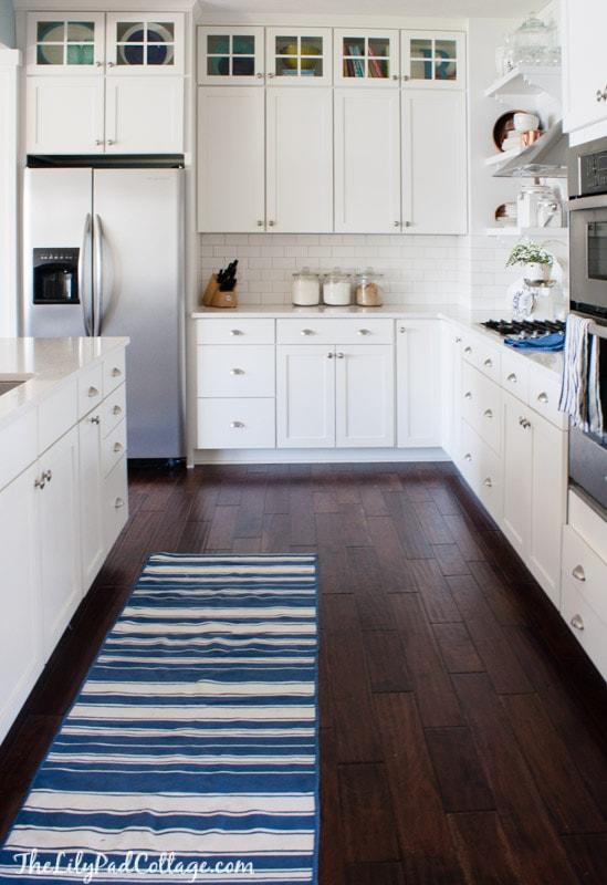 white-kitchen-blue-rug