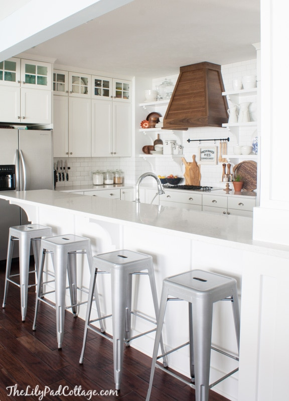 White Kitchen With Wood Range Hood