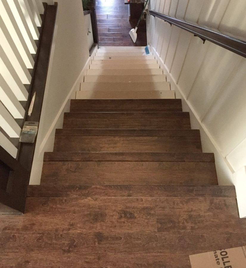 Stairway makeover swapping carpet for laminate the