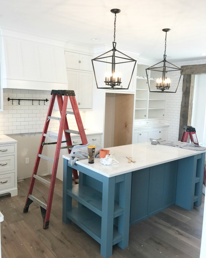 White kitchen blue island