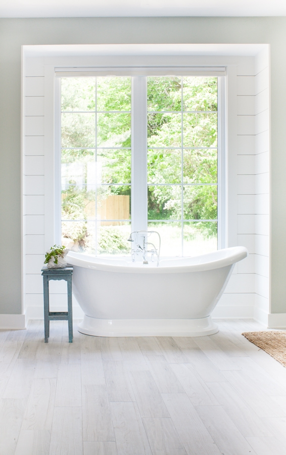 Cute I still love the look of the shiplap from my old master bathroom so I had the guys add it on the back wall behind the sinks and up behind the bath