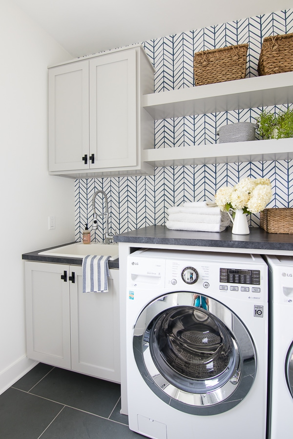 Wallpaper laundry room grey cabinets