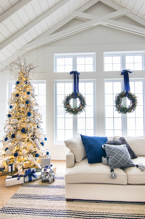Christmas tree with navy blue ornaments and white accents
