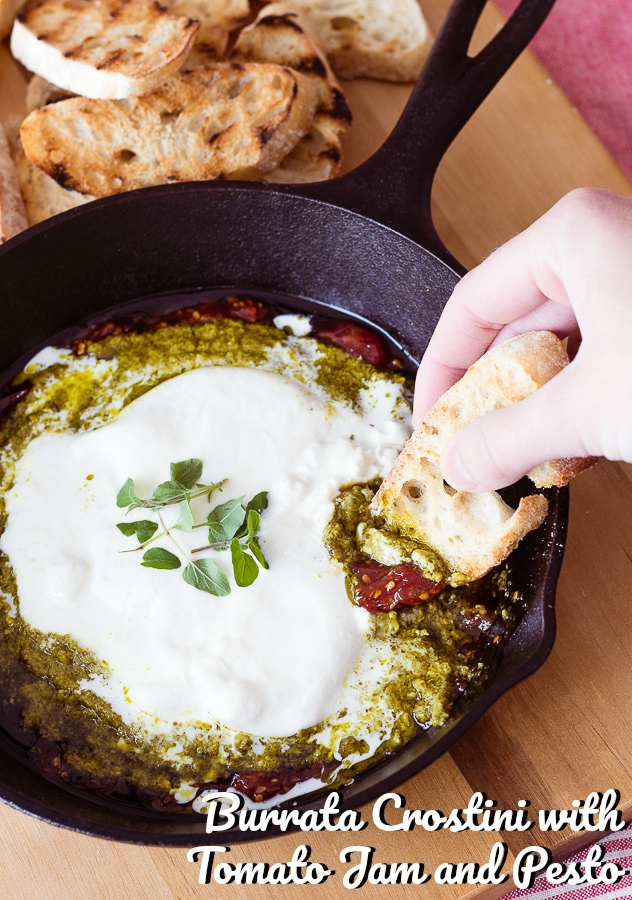 burrata cheese tomato jam and pesto in a skillet with toasted bread
