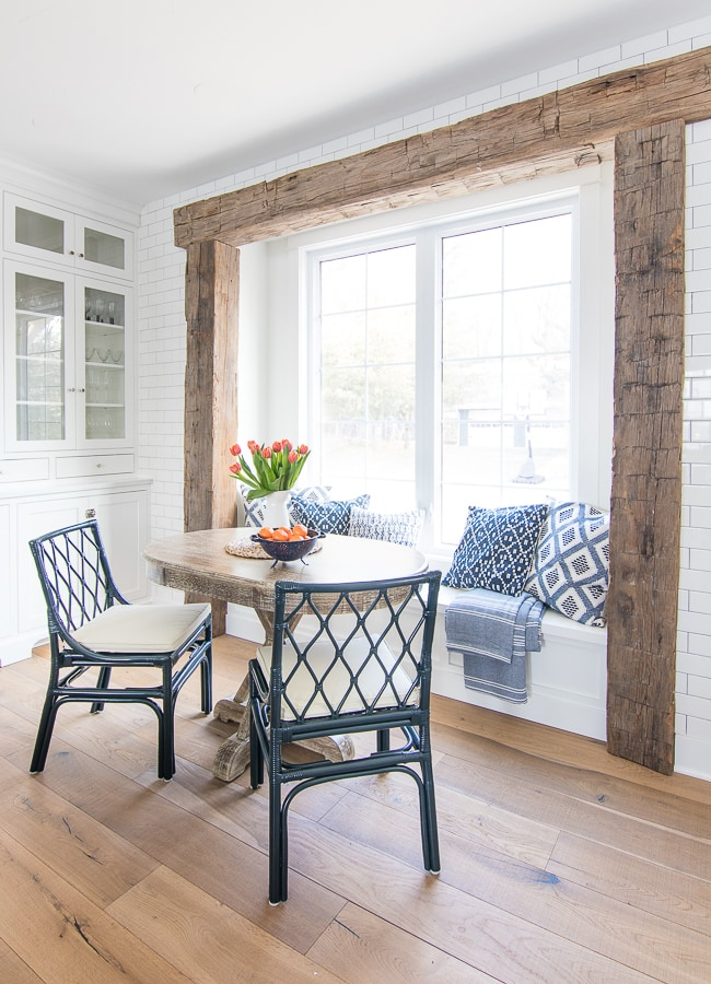 Lake house rustic beams breakfast nook navy chairs