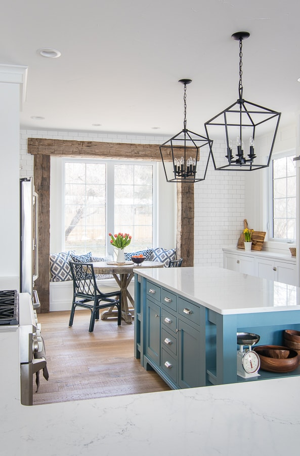 Lake house kitchen blue island and breakfast nook navy chairs