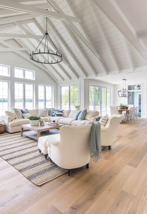 White paneled walls lake house living room decor