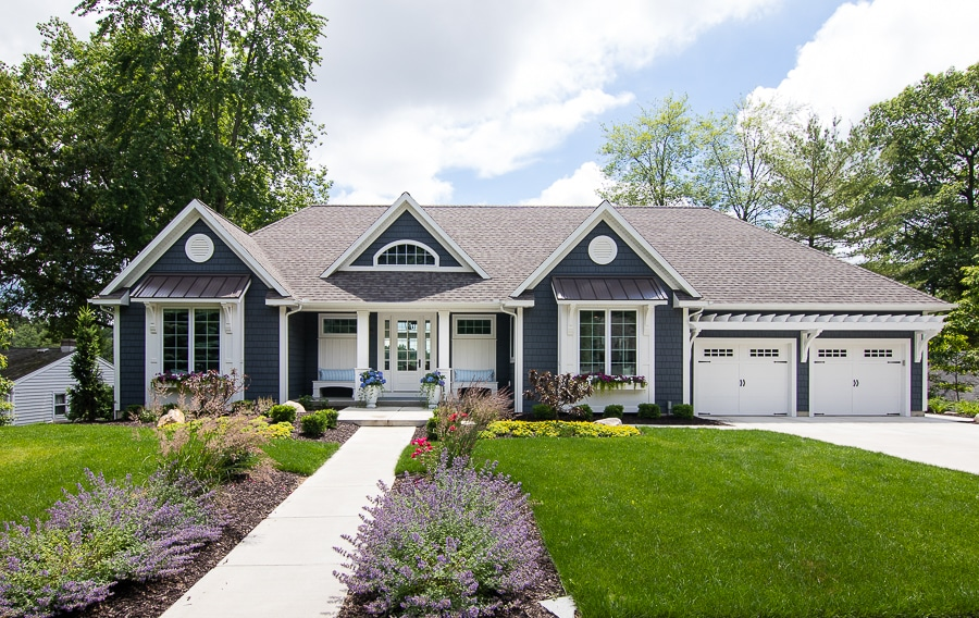 dark grey shake siding lake house