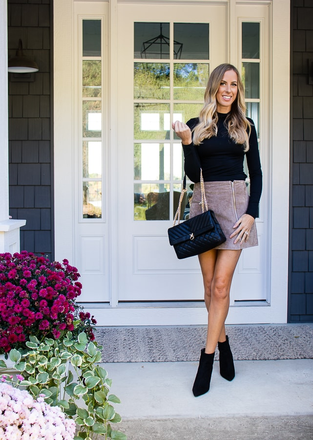suede skirt and black turtleneck outfit
