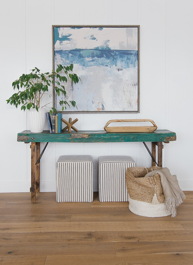 Green console table coastal decor and art striped ottomans