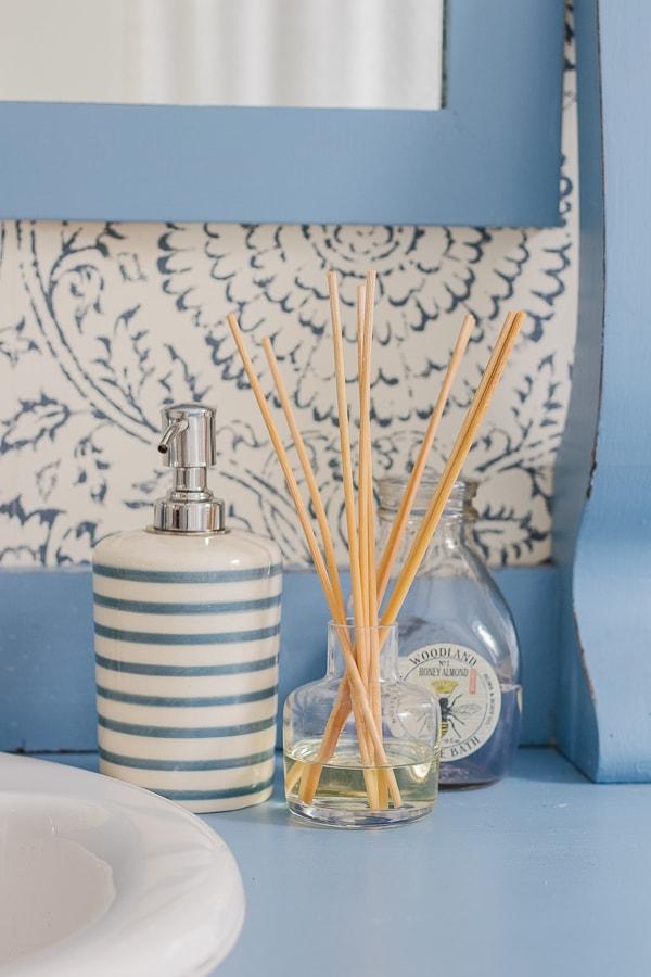 blue floral wallpaper blue vintage dresser turned vanity and penny tile