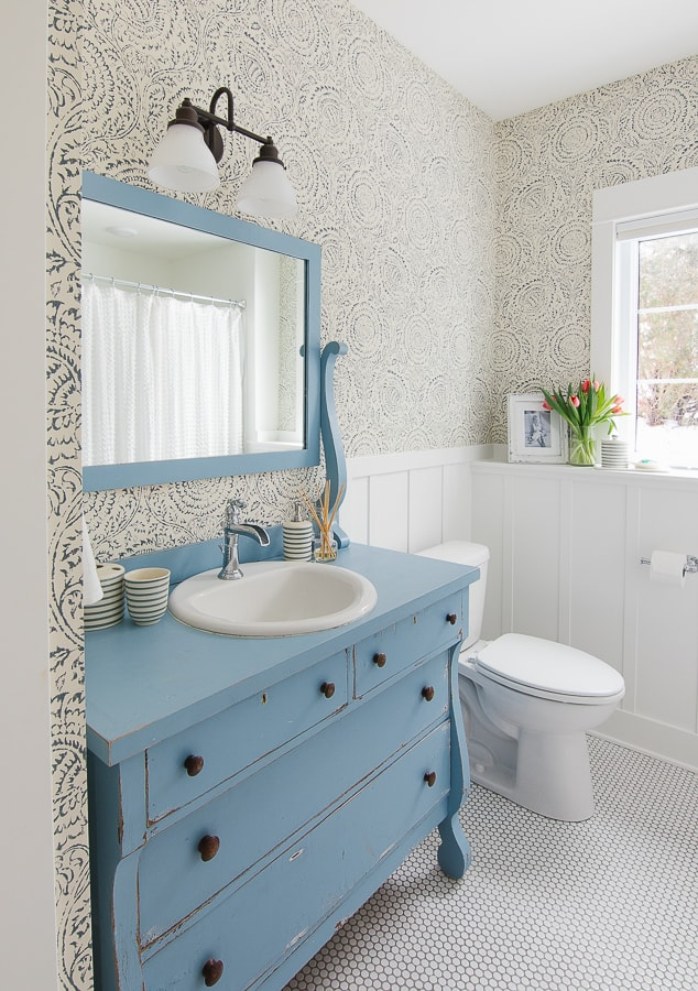 blue floral wallpaper blue vintage dresser turned vanity and penny tile
