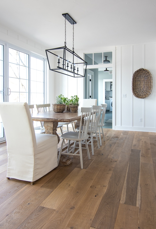dining room white chairs wood table wood flooring