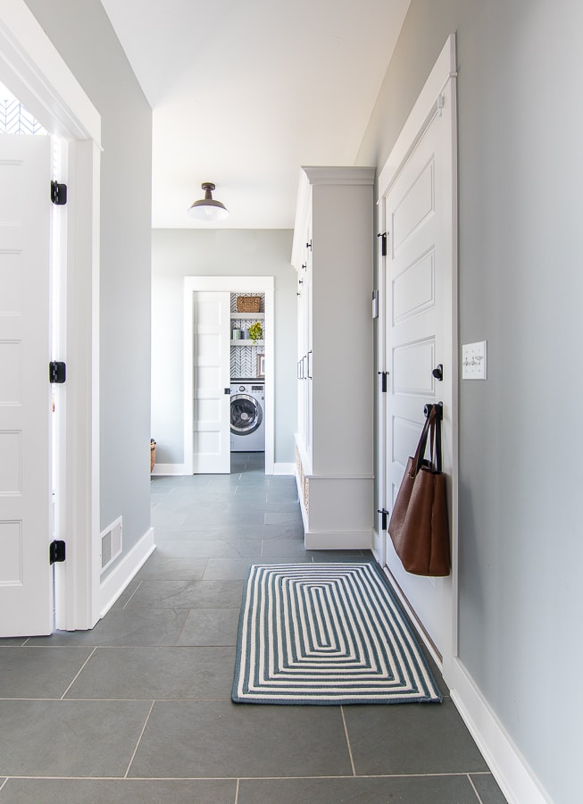 blue gray walls white cabinets slate floor mudroom