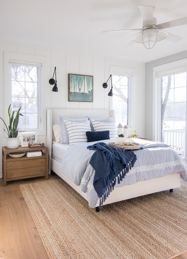 lake house master bedroom white bed wood nightstands