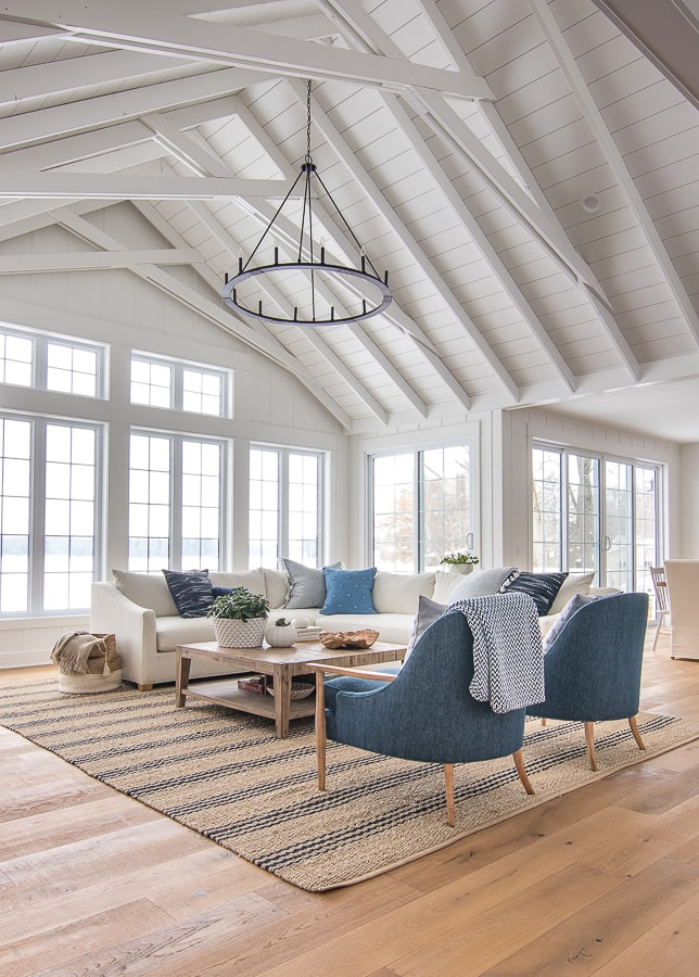 lake house living room white sectional sofa and navy accent chairs