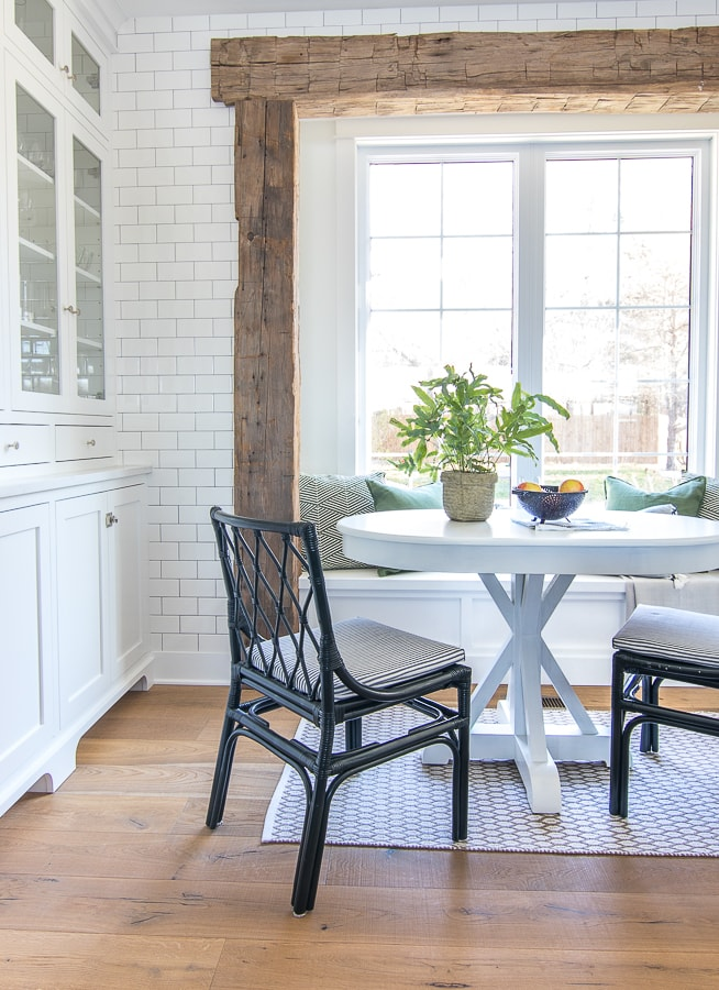 White table navy chairs rustic wood beams breakfast nook
