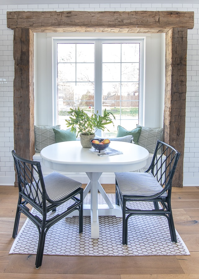 white breakfast nook table rustic beams blue chairs
