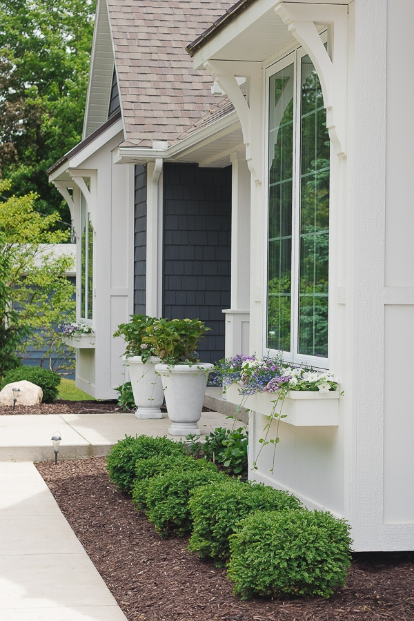 dark grey house landscaping design