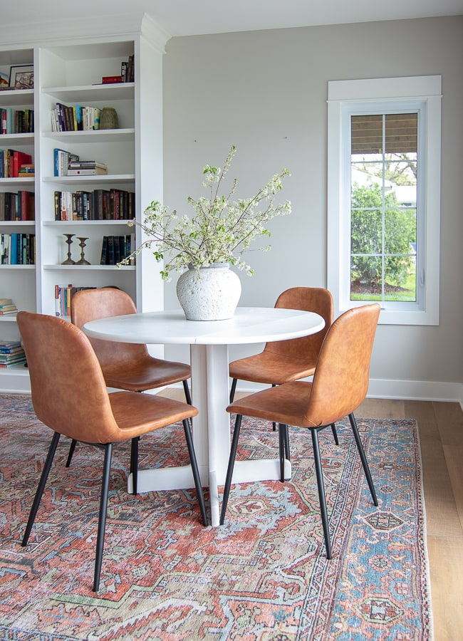 white dining table leather chairs
