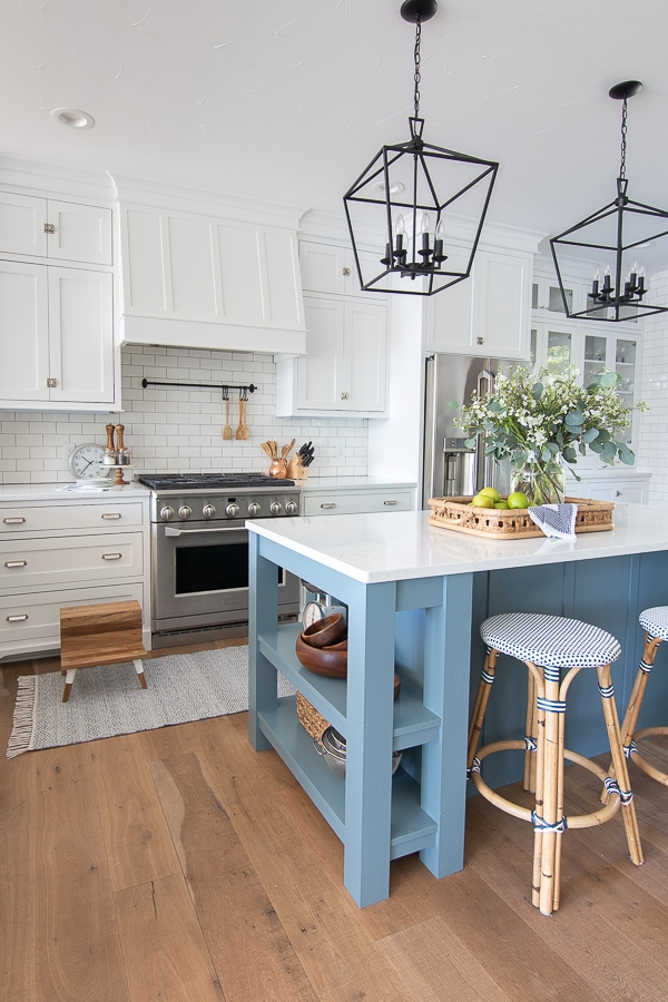 classic white kitchen blue island lake home