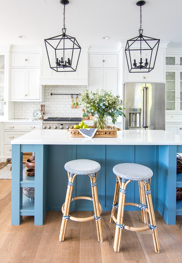 white kitchen blue island riviera bar stools black lanterns