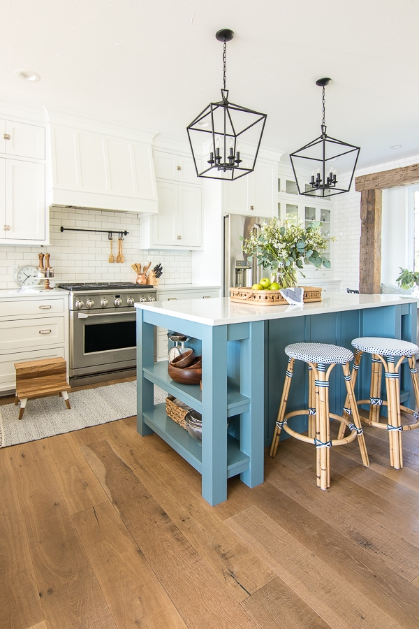 White kitchen blue island lake house kitchen
