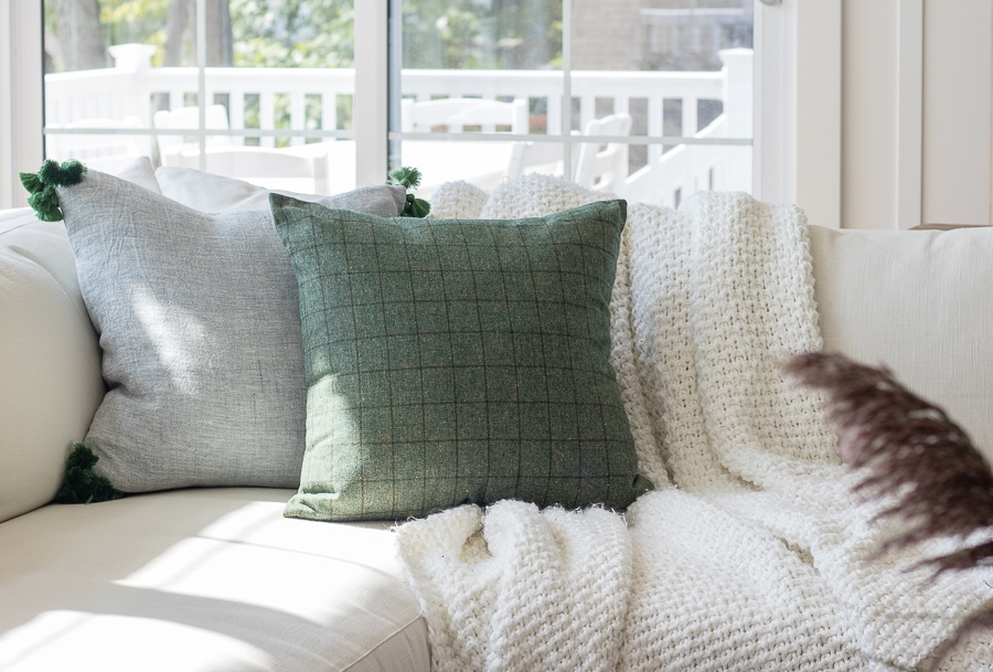 Green and oatmeal colored fall pillows