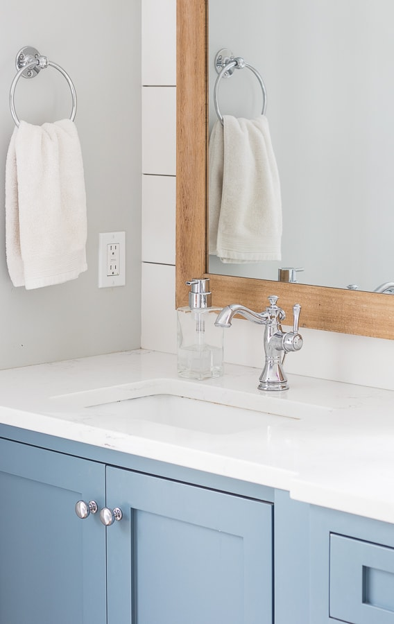 white and blue coastal master bathroom