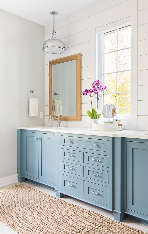 White and blue coastal lake house master bathroom blue cabinets