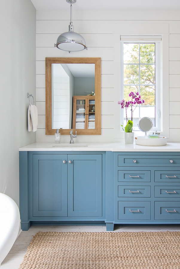 white and blue coastal master bathroom