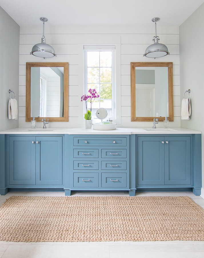 White and blue coastal lake house bathroom cabinets