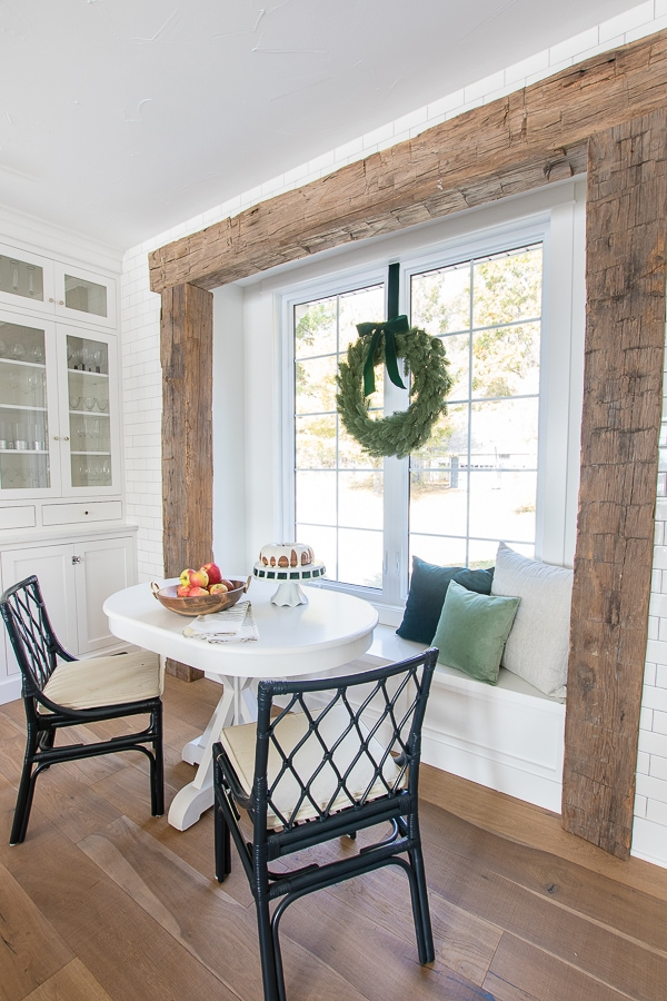Christmas kitchen decor. Breakfast nook rustic beams.
