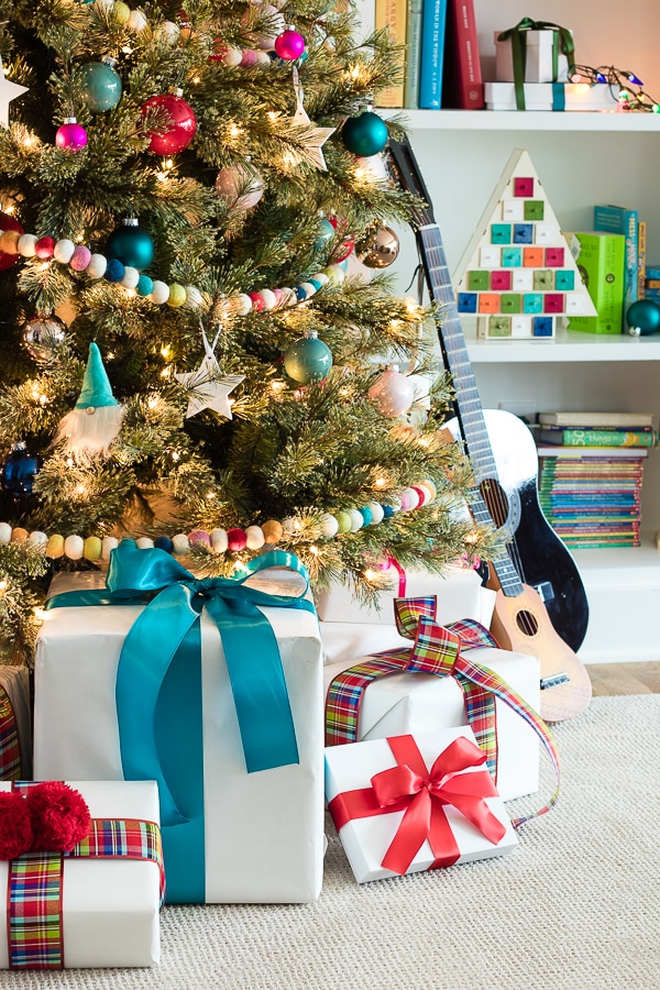 Colorful and fun kids Christmas tree rainbow colored presents
