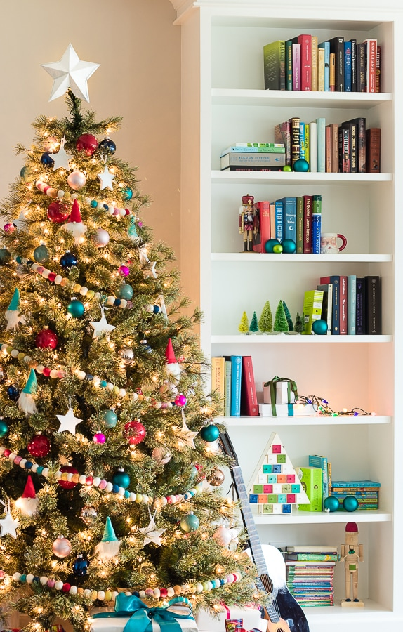bright and colorful Christmas tree and decor perfect for a kid space