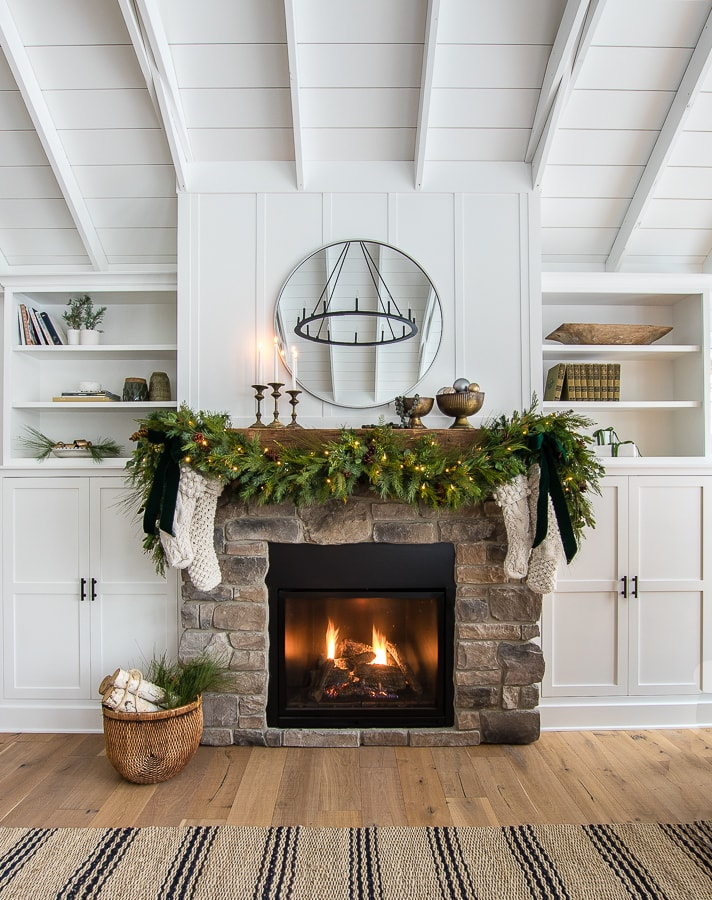 Simple brass and green Christmas mantel decor