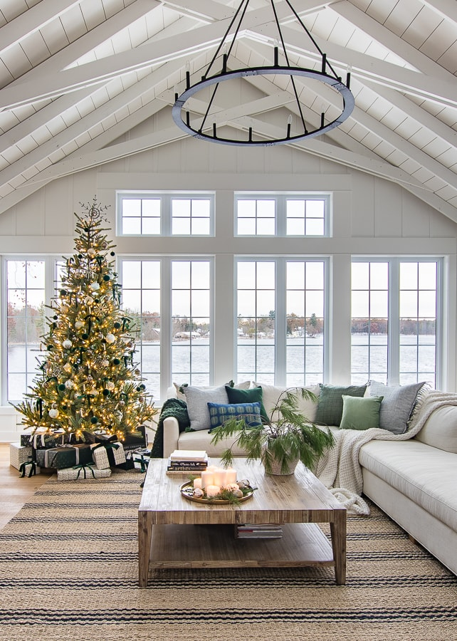 Lake house living room green and blue Christmas living room decor Christmas tree with green velvet ornaments and ribbon