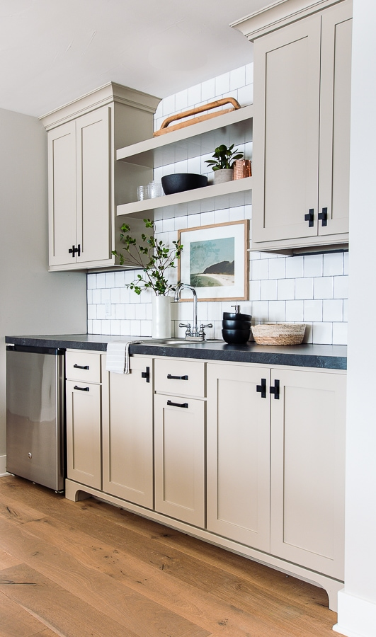 black countertop beige cabinets white tile