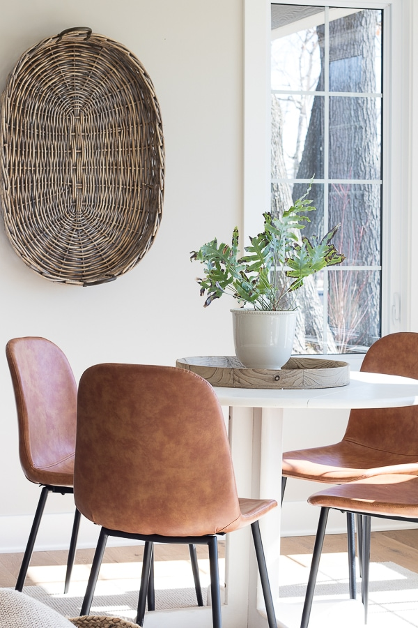 white round table and leather chairs