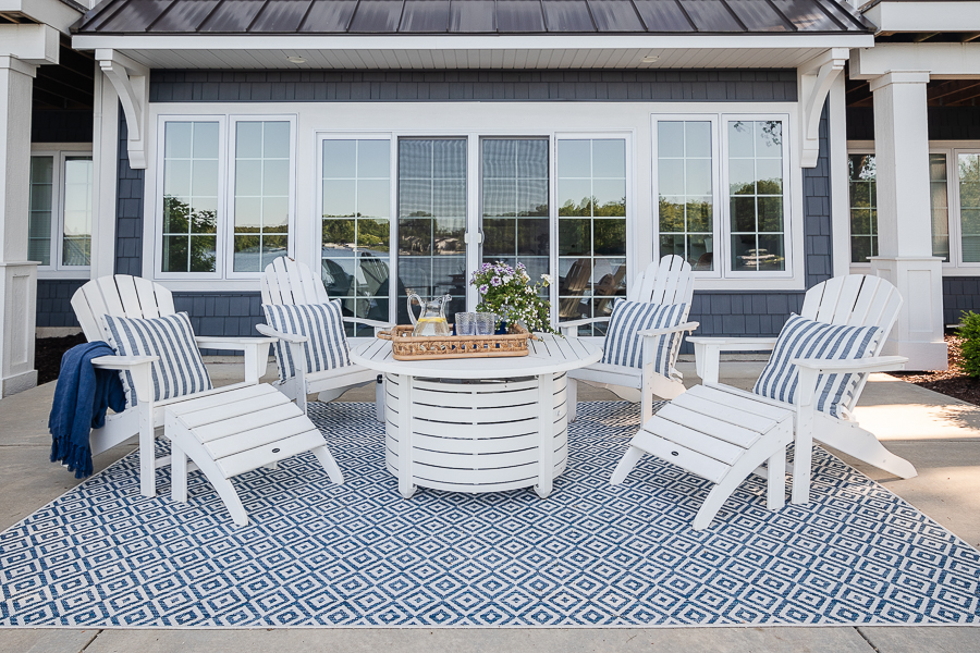 white adirondack chairs and white fire pit table