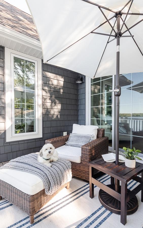 striped rug, wicker furniture, white umbrella, coastal decor
