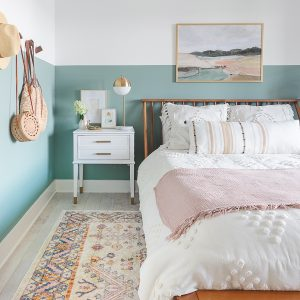 color blocked walls, wood hooks, wooden bed, white nightstands