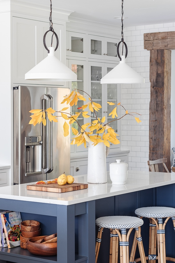 white pendant lights, navy island