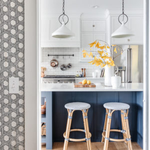navy and white kitchen with black wallpaper