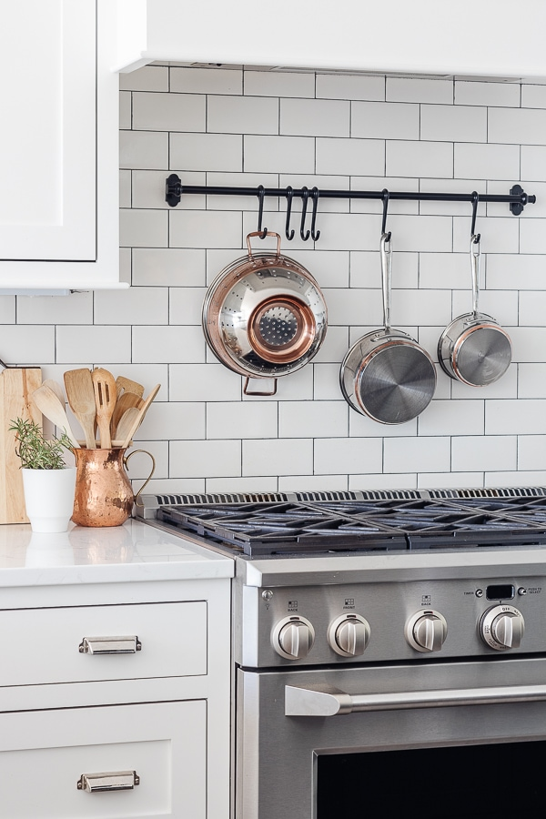copper kitchen accessories in a white kitchen