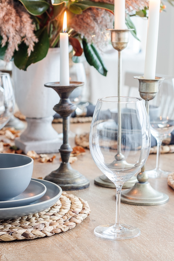 neutral table set for thanksgiving with fall flowers