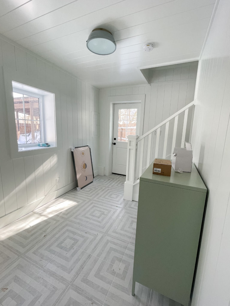gray and white patterned pool house tile white planked walls