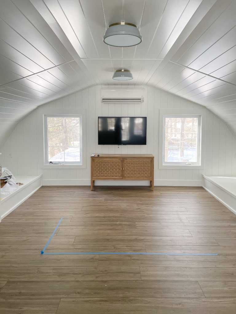 white planked walls wood floors bunk house room
