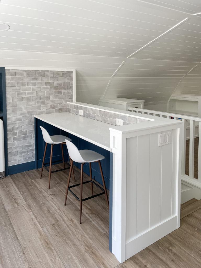 navy cabinets gray tile white quartz countertops pool house kitchen