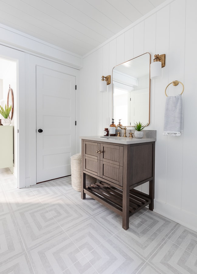 coastal bathroom gray patterned floors white paneled walls